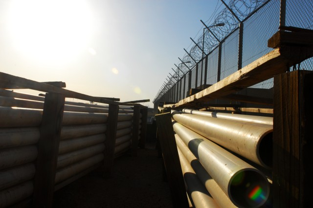 Piping that will form a network connecting the Camp Bucca wastewater treatment plant to the water treatment facility waits, ready for use. Once connected, the two facilities will provide a constant flow of water for the operation of the microbial filters of a new water treatment plant that will provide up to 1.2 million gallons of fresh water to several local municipalities.
