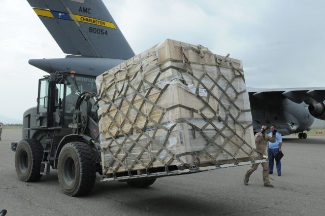 KULOB, Tajikstan-Members of the 21st Airlift Squadron use a forklift to remove a pallet full of tents off of a C-17 Globemaster to help aid displaced citizens of the recent floods in Tajikistan.  The airmen, along with members of Third Army, were able to provide a plane full of over $250,000 worth of tents after a call for international assistance by the Tajikistan government.  (Photo by Cpl. Brandon Babbitt, 203rd Public Affairs Detachment.)