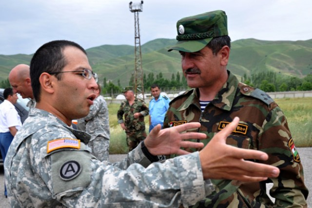 Spc. Saliyev Djamoliddin (left), a Third Army Soldier and native of Tajikistan, converses with a member of the Tajikistan Army at Kulob, Tajikistan, May 16.  Djamoliddin expressed his pleasure with being able to come back to his home country and make a difference as a member of Third Army while helping the flood victims of Tajikistan.