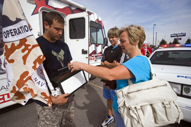 Iraq veteran Troy Yocum uses a Vietnam War-era ammunition can to collect donations for veterans and military families during his 7,000-mile walk across America.