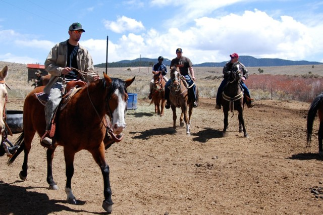 WESTCLIFFE, Colo.---Eagles Summit Ranch owner Dave Roever leads a group of wounded Soldiers on a horse ride April 22.
