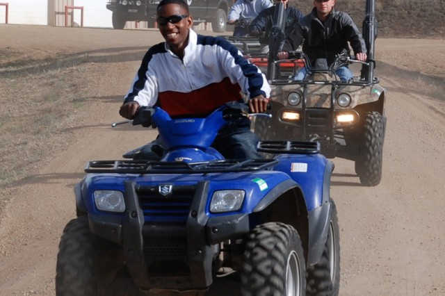 WESTCLIFFE, Colo.---Wounded Soldiers enjoy a ride on all-terrain vehicles at Eagles Summit Ranch April 22.