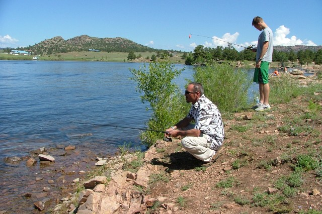 WESTCLIFFE, Colo.---A wounded veteran enjoys fishing while at Eagles Summit Ranch.