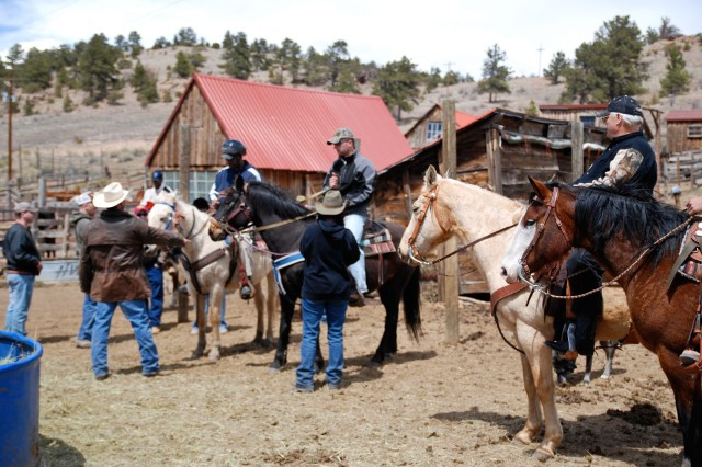 WESTCLIFFE, Colo.---Wounded Soldiers prepare for horseback riding at Eagles Summit Ranch April 22.