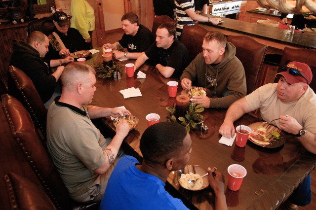 WESTCLIFFE, Colo.---Wounded Soldiers discuss their common issues over a meal at Eagles Summit Ranch.
