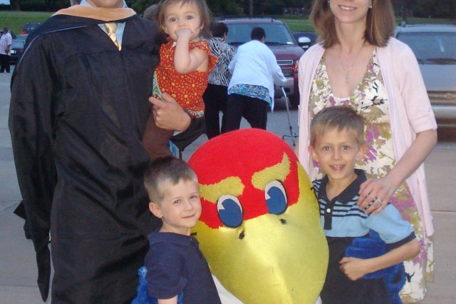 Sgt. Rob Laurent is one of the six soldiers who were the first to receive master's degrees as part of the Wounded Warrior Education Incentive. Laurent, his wife Briley and their three children visited with the University of Kansas Jay hawk.