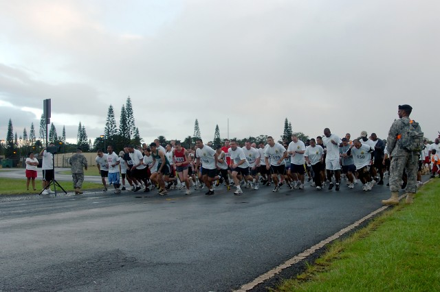 Runners competing in the 25th Infantry Division Equal Opportunity Asian Pacific American Heritage Month Run and Keiki Walk at Wheeler Army Airfield, May 15, sprint forward as the competition begins. The run celebrated the achievements of Asian-American and Pacific Islander citizens throughout the Nation's history and welcomed Soldiers and family to compete against one another for prizes. (U.S. Army photo by Spc. Jesus J. Aranda, 25th Infantry Division Public Affairs Office)