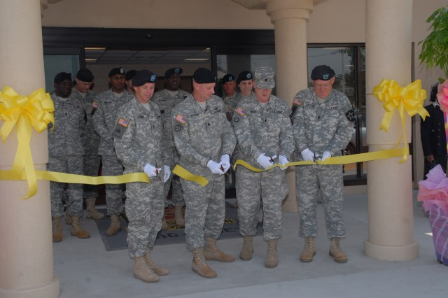 (From left) Col. Thomas Graves, Lt. Col. Richard Fromm, Casey Garrison commander, Lt. Col. Dale Smith, and Command Sergeant Maj. John Fortune cut the ribbon to reopen the Casey bus station May 17.