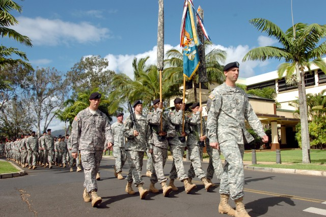 Maj. Paul Armstrong, S3, 25th Infantry Division Special Troops Battalion, leads the battalion's color guard along with Sgt. Maj. Matthew McCoy, S3 sergeant major, 25 STB, during a march to Sills Field, Schofield Barracks, Hawaii, May 18. The Soldiers of the 25th STB gathered for a battalion inactivation, reorganization and redesignation ceremony, officially becoming the Headquarters and Headquarters Battalion.