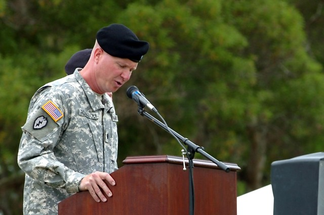 "Lt. Col. Paul D. Romagnoli, commander, Headquarters and Headquarters Battalion (HHBN), 25th Infantry Division (left), speaks to a formation of HHBN Soldiers during a battalion inactivation, reorganization and redesignation ceremony at Sills Field, here, May 18. The 25th Special Troops Battalion officially became HHBN during the ceremony and the battalion, and its subordinate companies, retired their former colors, adopting new guidons to represent their organizations.  ""One thing has always remained the same,"" said Romagnoli, to the audience. ""The Soldiers standing before you, and those who served before them, have always executed their missions with utmost professionalism by providing administrative, life support, training or security in one form or another to enable the commanding general and the division headquarters the ability to command and control."""