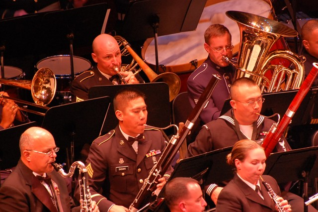 Army Sgt. Robert Carmical, trombone player, 25th Infanty Division Band, 25th Special Troops Battalion, 25th Inf. Div., (top row) performs with musicians from the Navy, Air Force, Marines, Coast Guard, and the Hawaii Army National Guard during the combined military band concert May 15 at the Hawaii Theatre, Honolulu. (U.S. Army photo by Staff Sgt. Tim Meyer, 25th Inf. Div. Public Affairs.)
