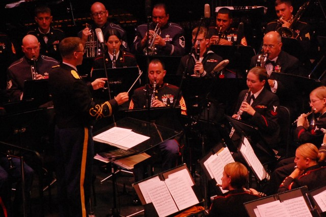Army Chief Warrant Officer Joseph Parenteau, commander, 25th Infanty Division Band, 25th Special Troops Battalion, 25th Inf. Div., conducts musicians from the Army, Navy, Air Force, Marines, Coast Guard, and the Hawaii Army National Guard during the combined military band concert May 15 at the Hawaii Theatre, Honolulu. (U.S. Army photo by Staff Sgt. Tim Meyer, 25th Inf. Div. Public Affairs.)