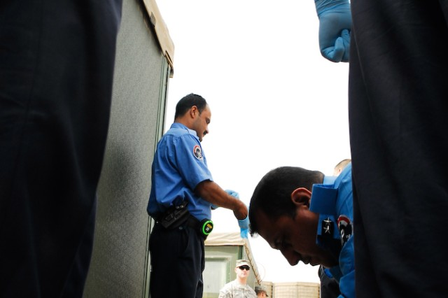 Members of the Iraqi Police prepare to investigate a crime scene during the final evaluation of their two-week evidence collection course hosted by 203rd Military Police Battalion in Basrah, Iraq.