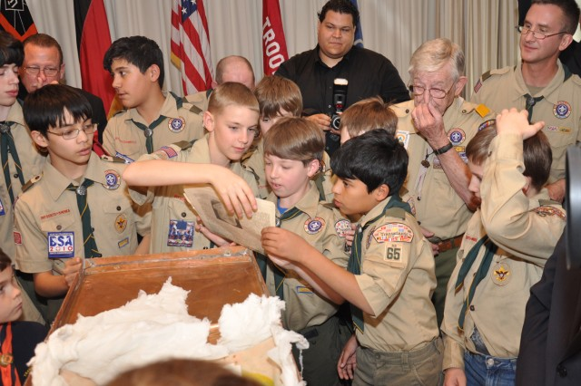 Wiesbaden Boy Scouts from Troop 65 join veterans from Troop 11 in opening a 50-year-old time capsule placed by the Troop 11 Scouts in 1961 in a former U.S. military hotel.