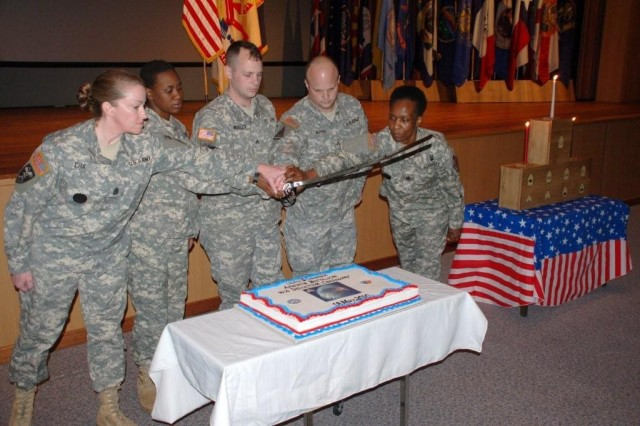 The ceremony concluded with a cake cutting led by (L-R) AFNORTH Battalion Command Sgt. Maj. Joanne M. Cox, Sgt. Sasha Sween, Sgt. Gerald Wesley, Sgt. Richard Norris and USAG Schinnen's Command Sgt. Maj. Mary L. Brown.