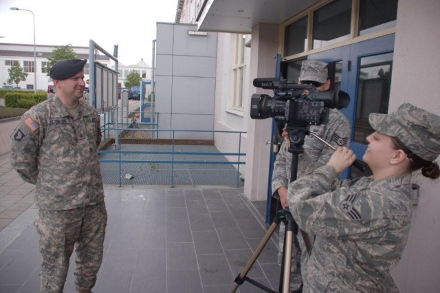 One of USAG Schinnen's newly inducted NCO's, Sgt. Craig Kosobucki gives an interview to American Forces Network reporter, Senior Airman Amanda Wowk after the ceremony.