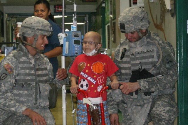 Making them smile:  Soldiers bring cheer to sick children