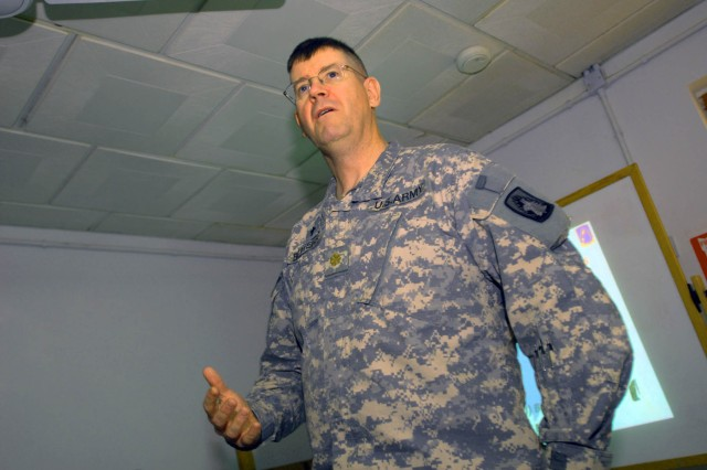 Chaplain (Maj.) Tom Bowers, who calls parts of Michigan home among other places, emphasizes the benefits of financial planning and discipline to the group of more than 20 Soldiers from the 12th Combat Aviation Brigade and Task Force 12 at the Contingency Operating Base Adder, Iraq, Main Post Chapel May 5, 2010.