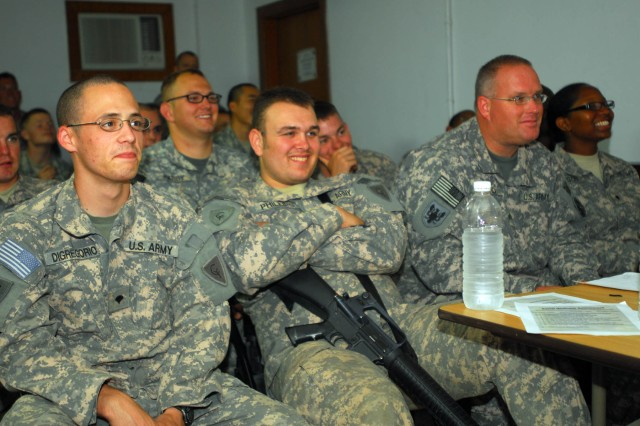 Soldiers from throughout the 12th Combat Aviation Brigade's Task Force 12 on Contingency Operating Base Adder, Iraq, listen intently to one of the more humorous videos used as training aids during the resiliency training given May 5, 2010, at the COB Adder Main Post Chapel. Capt. Jason Cage, one of the flight surgeons for the brigade with the 412th Aviation Support Battalion and native of Richmond, Va., gave his class on social wellness as the second half of the two-part training for this May.