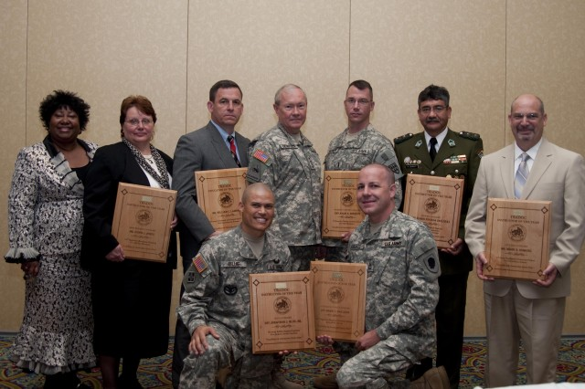 Gen. Martin E. Dempsey, TRADOC commander, recognized the instructors of the year at the Army Training and Education Development Summit on Tuesday in Newport News, Va.