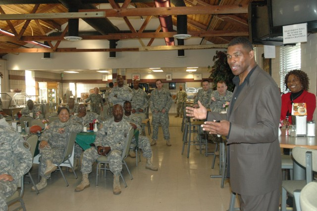 Herschel Walker, University of Georgia football legend and Heisman Trophy winner, talks to Soldiers at the WTU dining facility, May 13. Walker visited Fort Stewart, among other military bases, to talk to Soldiers about his fight with dissociative identity disorder - the strength it takes the admit your problem, and the relief he felt once he was able to face it and deal with it.