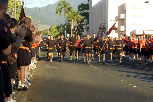 SCHOFIELD BARRACKS, Hawaii - Col. Walter Piatt leads 3rd Brigade Combat Team during the 25th Infantry Division run, here, May 19. The many brigades, battalions and companies of the 25th Inf. Div. gathered together for a 4.5-mile organized run throughout the post. (U.S. Army photo by Spc. Mahlet Tesfaye, 25th Inf. Div. Public Affairs.)