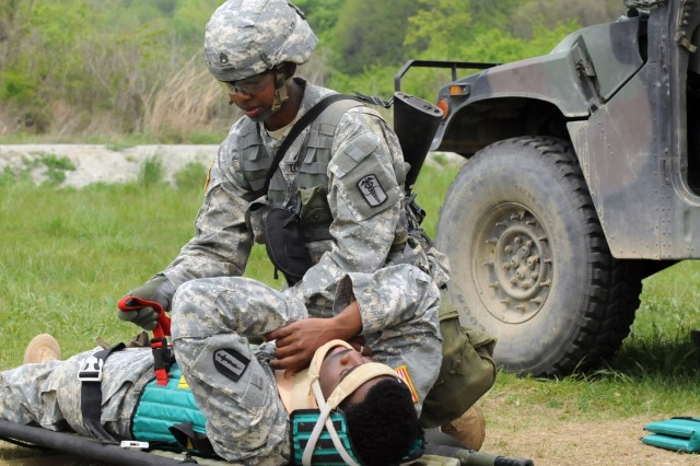 A candidate tends to a simulated spinal injury during the Expert Field Medical Badge qualification at Warrior Base May 17.