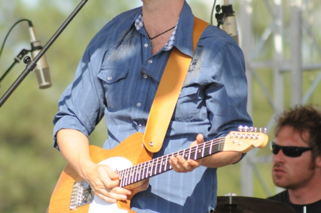 B.J. Craven, lead singer and guitarist of the band Ten Toes Up, performs one of the band's original songs. The Murrells Inlet-based quartet entertained with a blend of funk and rock.