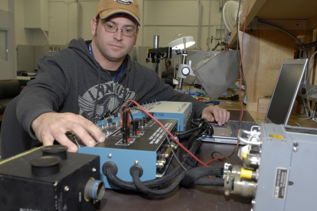Fred Granoski, electronics mechanic, performs setup and repair of an AN/APX-124 transponder.  Granoski joined forces with a coworker to develop an interface box and cabling to test the Air Force's latest identify friend or foe equipment.