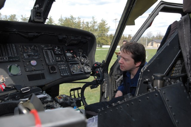 Darrin Sheare, electronics worker, checks out the communications instrument processor used in the Black Hawk helicopter, which he works on.