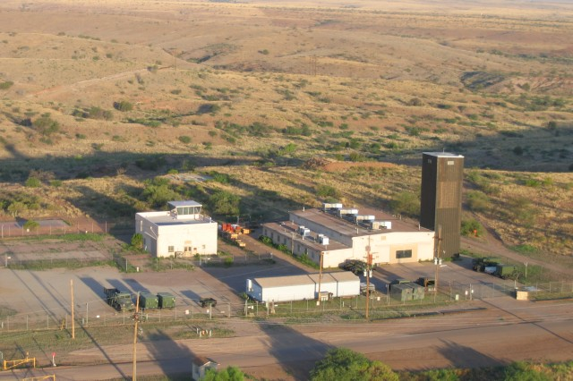 This photo of the Unmanned Aircraft System Training Battalion facility at Black Tower was taken from an ultralite aircraft about four years ago. The black tower, after which the facility is named and clearly seen in this photo, was formerly used to dry parachutes. The UASTB facility looks very different today due to continuous construction at the site as UASTB continues to expand its mission to support the Army's increased reliance on UASs in the Global War on Terrorism.