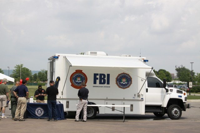 "FBI provides youth fingerprinting during ""Behind the Gates of Redstone Arsenal"" at Bridge Street Town Centre on May 15."