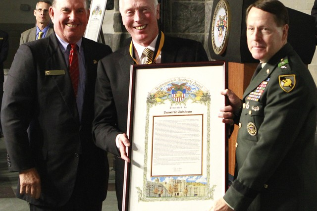 Retired Lt. Gen. Daniel W. Christman, Class of 1965 and former Superintendent, is presented one of the five Distinguished Graduates awards by Jodi K. Glore, Chairman of the West Point Association of Graduates, and current West Point Superintendent Lt. Gen. Buster Hagenbeck in Washington Hall.