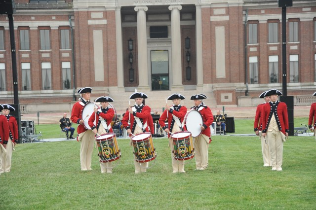 """The U.S. Army Fife and Drum Corp's Drum Line"""" demonstrate precision during the drum solo."""