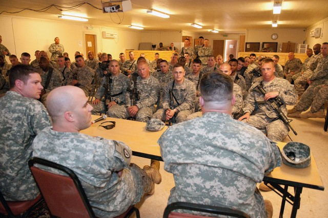 Paratroopers with 1st Brigade, 82nd Airborne Division (Advise and Assist) ask questions of wounded warriors visiting Camp Ramadi, Iraq, May 10, 2010, with Operation Proper Exit. This is the sixth group of severely-wounded veterans to visit Iraq since the program began in 2009.