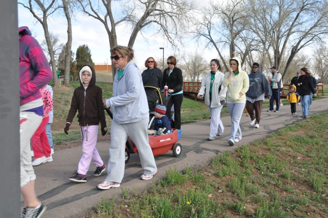 FORT CARSON, Colo.--- Family members of the 3rd Brigade Combat Team, 4th Infantry Division, start their mile-long walk during the Walk to Iraq and Back event held at Ironhorse Park April 24.