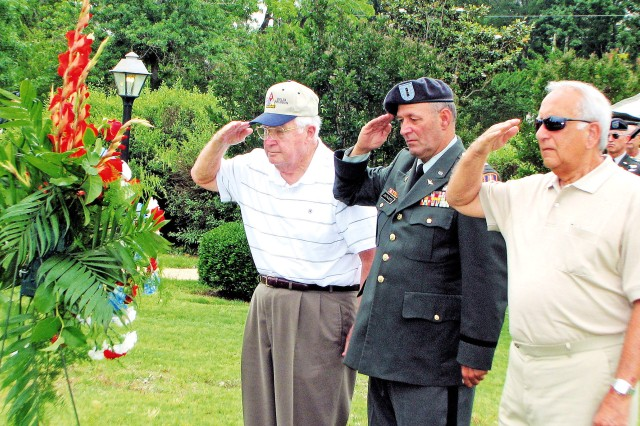 From left, retired Col. Harry Harper, former commander of 13th CAB; CW4 Larry Castagneto, 162nd AHC pilot during Vietnam and current 1st Bn., 13th Avn. Regt. safety officer; and retired Col. Edward Tolfa, the last 13th CAB commander in Vietnam, salute a memorial wreath at Veterans Park Sunday honoring fallen comrades.