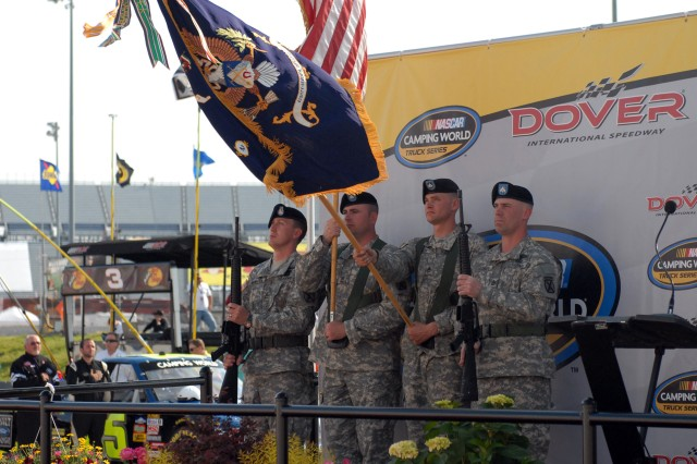 Soldiers with 2nd Battalion, 87th Infantry Regiment, present the colors at the opening ceremonies of the NASCAR Camping World Truck Series race held May 14 at Dover International Speedway in Dover, Del. From left are Sgt. 1st Class Charles McMillen, career counselor for 2-87 Infantry, 1st Sgt. Harold Hill, Staff Sgt. Derrick Martin and Sgt 1st Class Stephen Eldred, all from Company B, 2-87 Infantry.