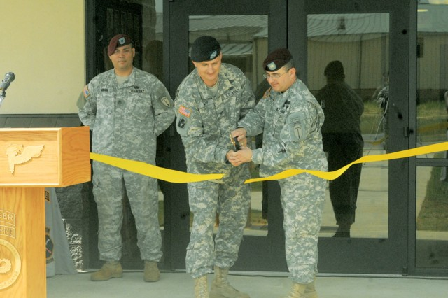 COL Steven Bapp, center, and LTC Robert Harris cut the ribbon outside the new WTC headquarters building Monday.