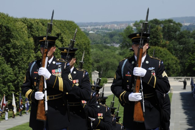 Soldiers from the 3d U.S. Infantry Regiment (The Old Guard) participate in a wreath laying ceremony at the Tomb of the Unknown Soldier in honor of the President of Mexico's arrival to Washington, DC., May 20, 2010.