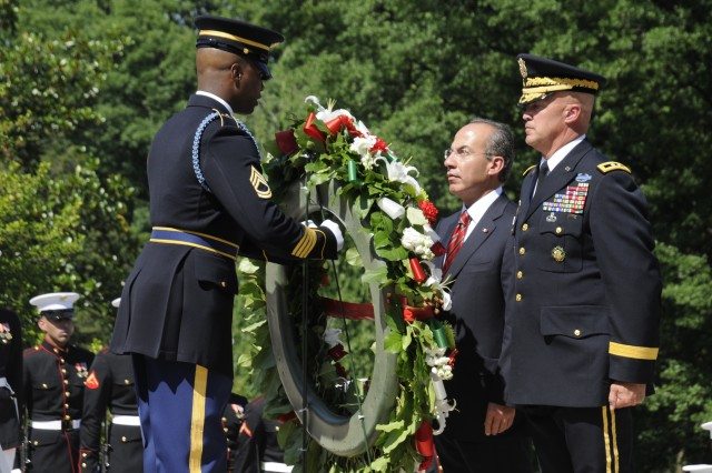 Maj. Gen. Karl Horst, commander, Joint Force Headquarters/ National Capital Region and the U.S. Army Military District of Washington stands attentively as the President of Mexico lays a wreath at the Tomb of the Unknown Soldier with the assistance of Sgt. First Class Alfred Lanier, Sergeant of the Guard for the Tomb of the Unknown Soldier, at Arlington National Cemetery, May 20, 2010.