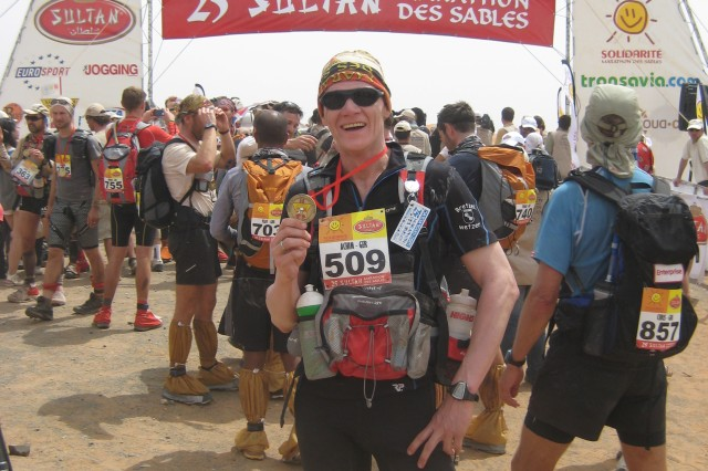 Achim Knacksterdt, chief of the Technical Engineering Section at the U.S. Army Corps of Engineers Europe District, holds up his medal received upon completion of the 25th annual Marathon Des Sables April 10, 2010, in the Sahara Desert. Knacksterdt completed the race in 38 hours, 48 minutes, 50 seconds earning him 201st place out of the 923 who completed the race and fifth place out of the 35 German runners.