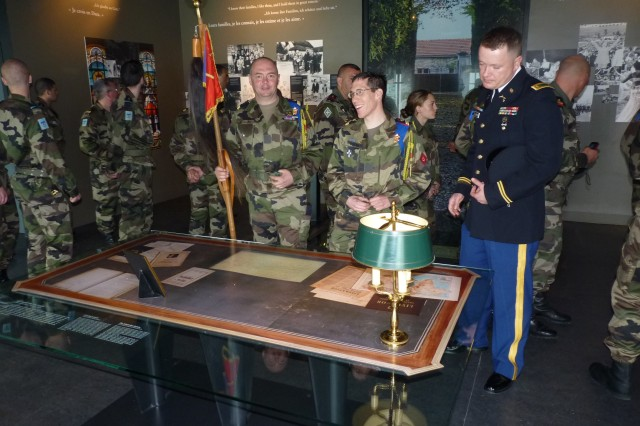 2nd Lt. Yan Burian, a member of Company D, 457th Civil Affairs Battalion, looks at an old map displayed on a desk during the tour of the Colomey museum in Colombey-les-Deux-Eglises, France, May 9.