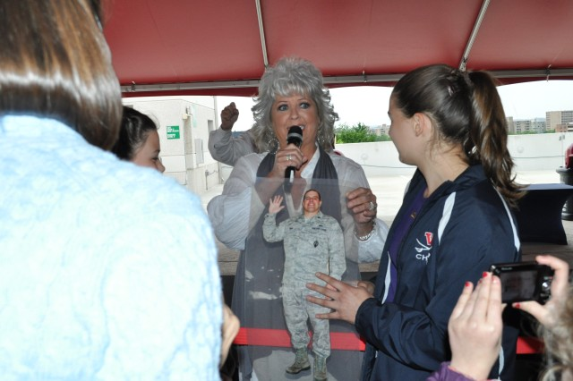 Renowned Southern chef and Food Network star, Paula Deen visited with troops before the May 19 Washington Nationals game. The pregame reception offered a chance for families to interact with Deen and pose for pictures as she did here with a cut out of a deployed Air Force father.