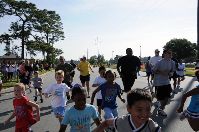 Runners ages 7-8 begin a 1-mile run as part of Armed Forces Kids Run, held at Stewart's Jordan Gym, May 15.