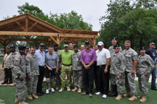 Soldiers undergoing treatment and rehabilitation at Brooke Army Medical Center welcome Valero Texas Open professional golfers at the Warrior and Family Support Center prior to a barbecue hosted by Birdies for the Brave and served by Rudy's BBQ May 11 at Fort Sam Houston.