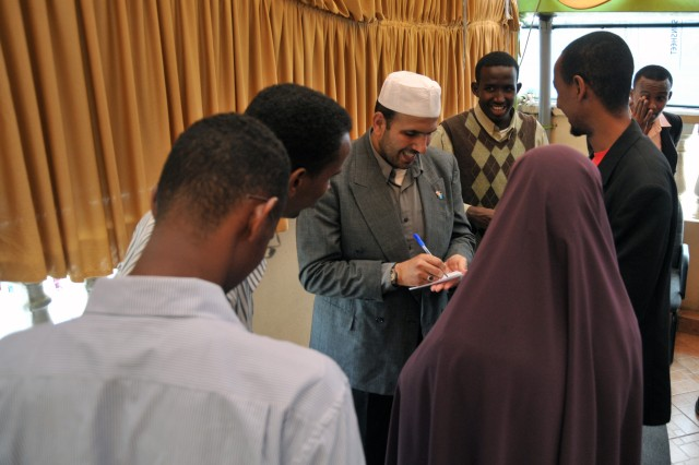 Several Somali youth crowd around U.S. Air Force Capt. Walid Habash following a meeting with 37 Somalian young adults May 3. Habash, a Muslim chaplain, traveled with two other military chaplains to represent an interfaith delegation meeting with community leaders during a trip across several countries in East Africa.
