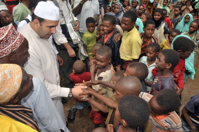 Children of Shumba Mjini Village gather to meet Chaplain Walid Habash during his visit April 29. Habash, a U.S. Air Force captain, traveled throughout East Africa to strengthen relationships between the U.S government and Muslim communities.