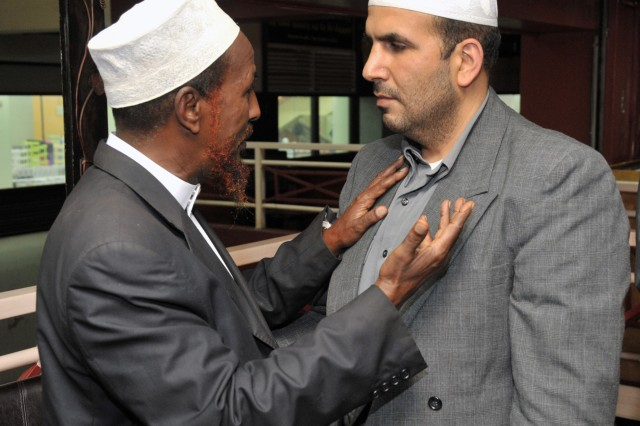 Sheikh Ali Mataan (left) speaks with Muslim chaplain Walid Habash following a meeting between several Somali Imams and U.S. military chaplains at a restaurant in Nairobi, Kenya, May 2. Imam Habash, a U.S. Air Force captain, traveled throughout East Africa to strengthen relationships between the U.S government and Muslim communities.