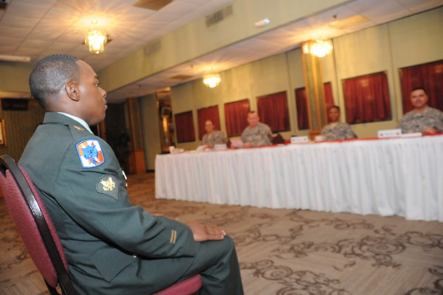 Spc. Timothy Stephens, Fort Lee, faces the board during the Installation Management Command-Northeast Region Soldier and Noncommissioned Officer of the Year Competition May 18.
